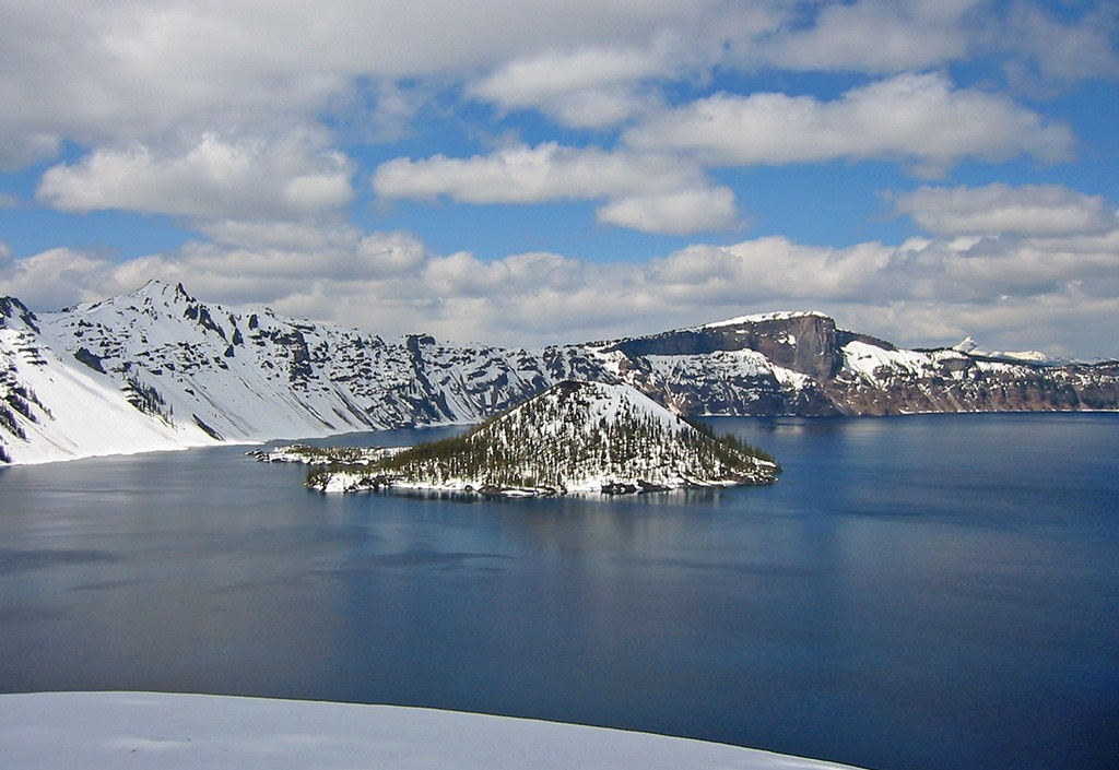 Snow-covered Wizard Island and Crater Lake.